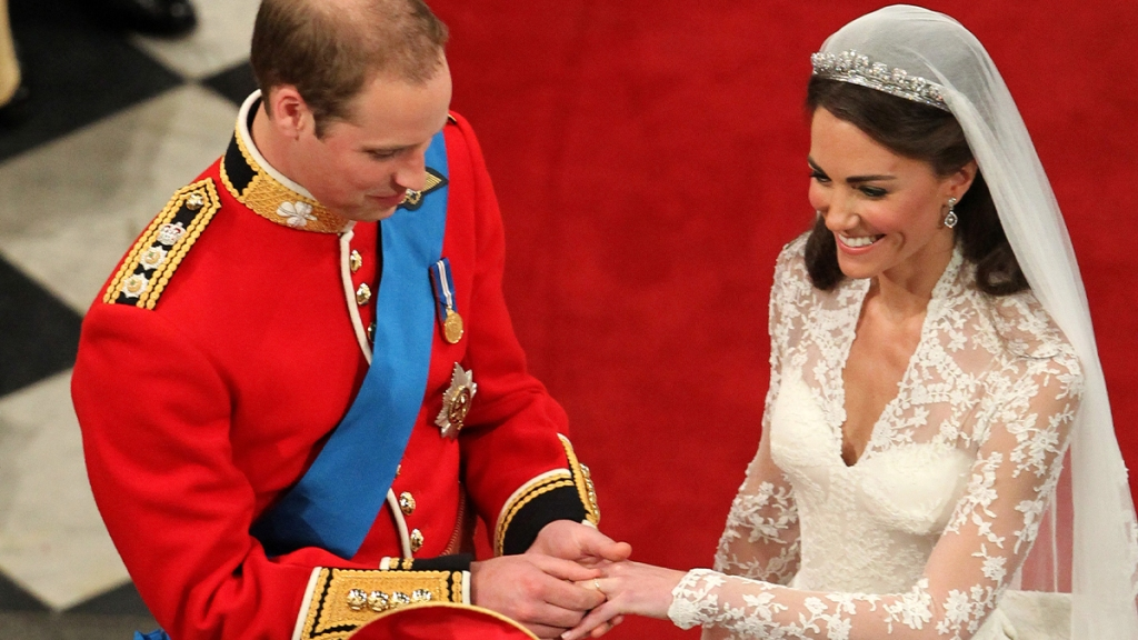William placing Kate's wedding band on her ring finger