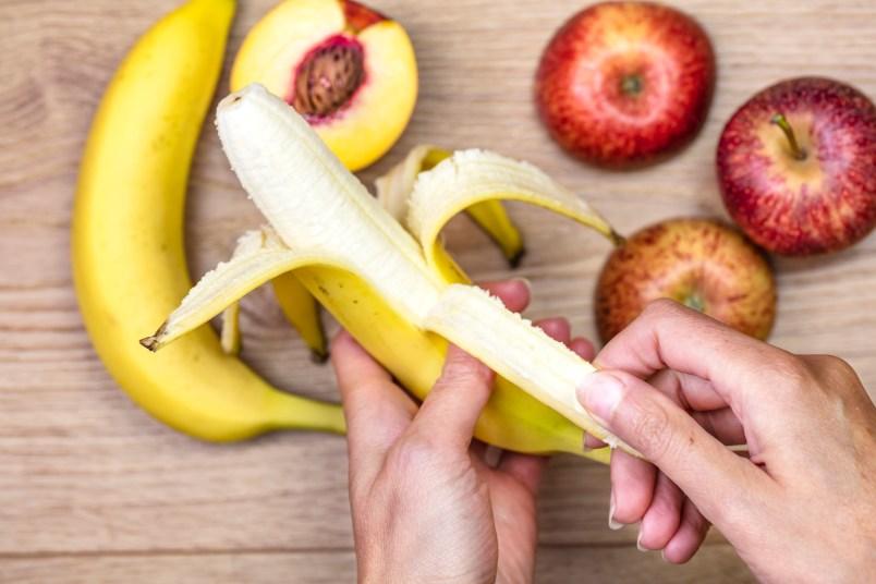 woman peeling banana