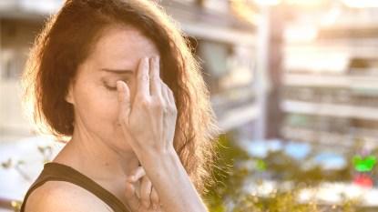 woman with a summer headache