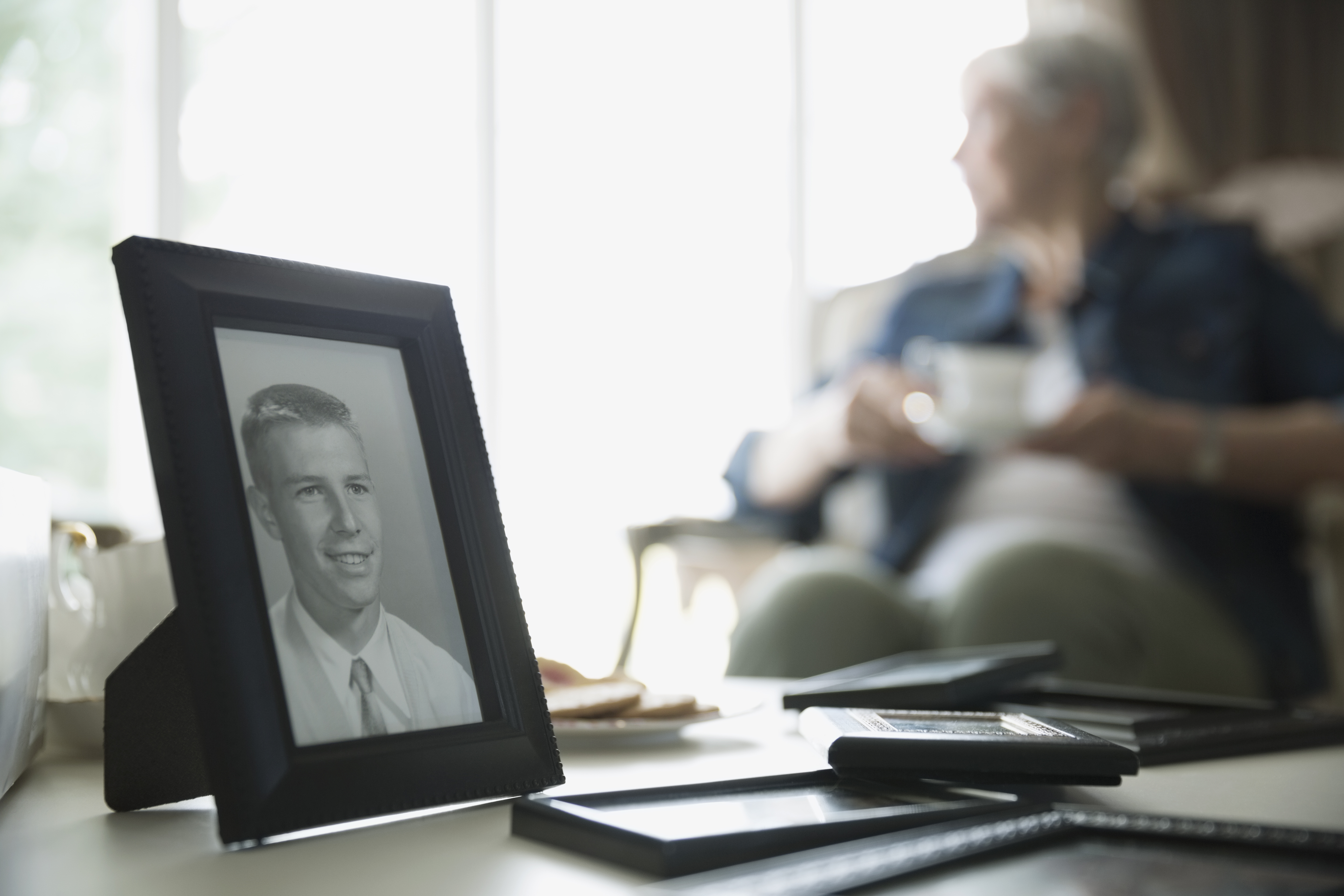 Old Woman with Photo of Young Man