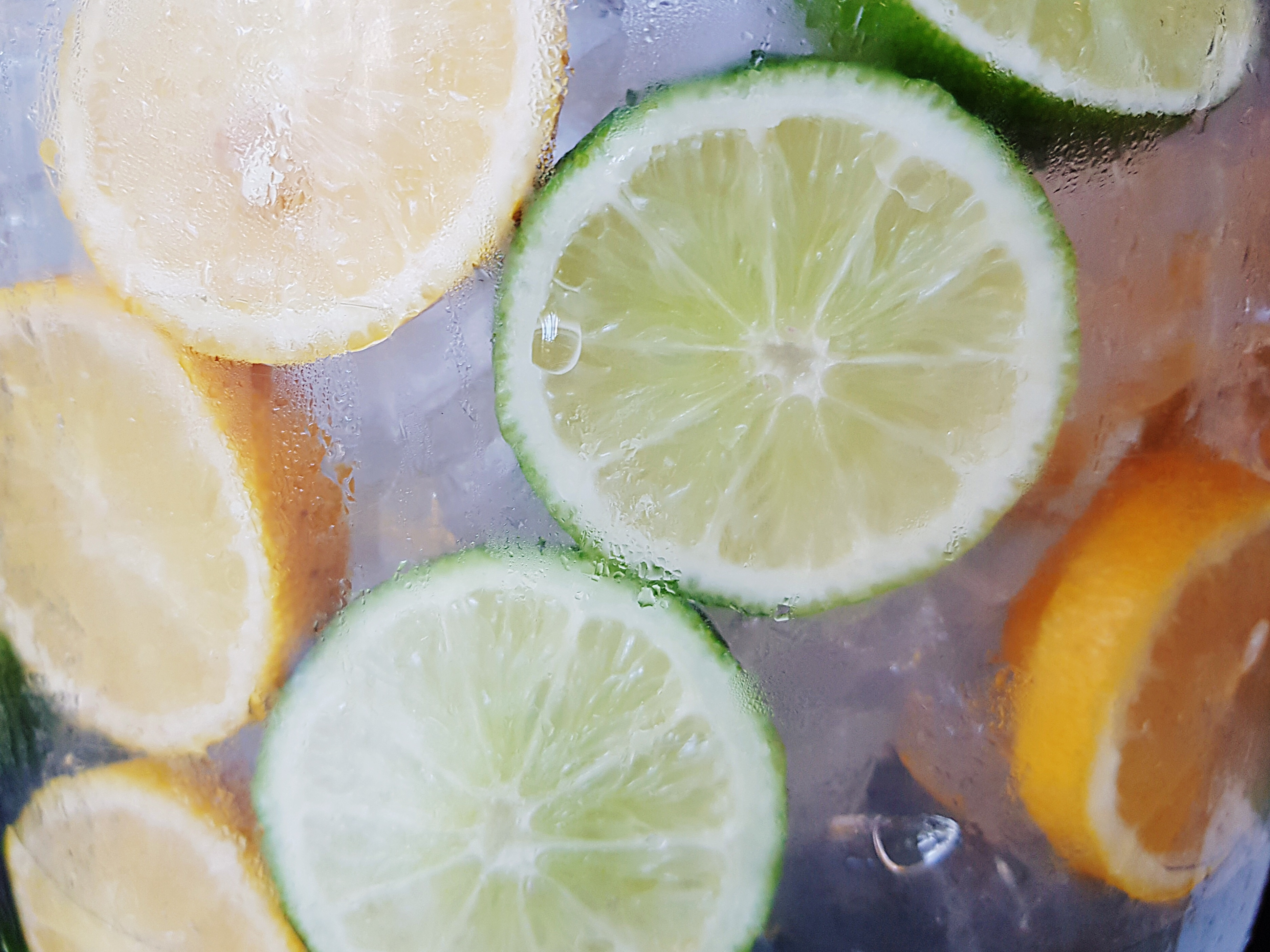 Frozen lemons and limes in a jar.