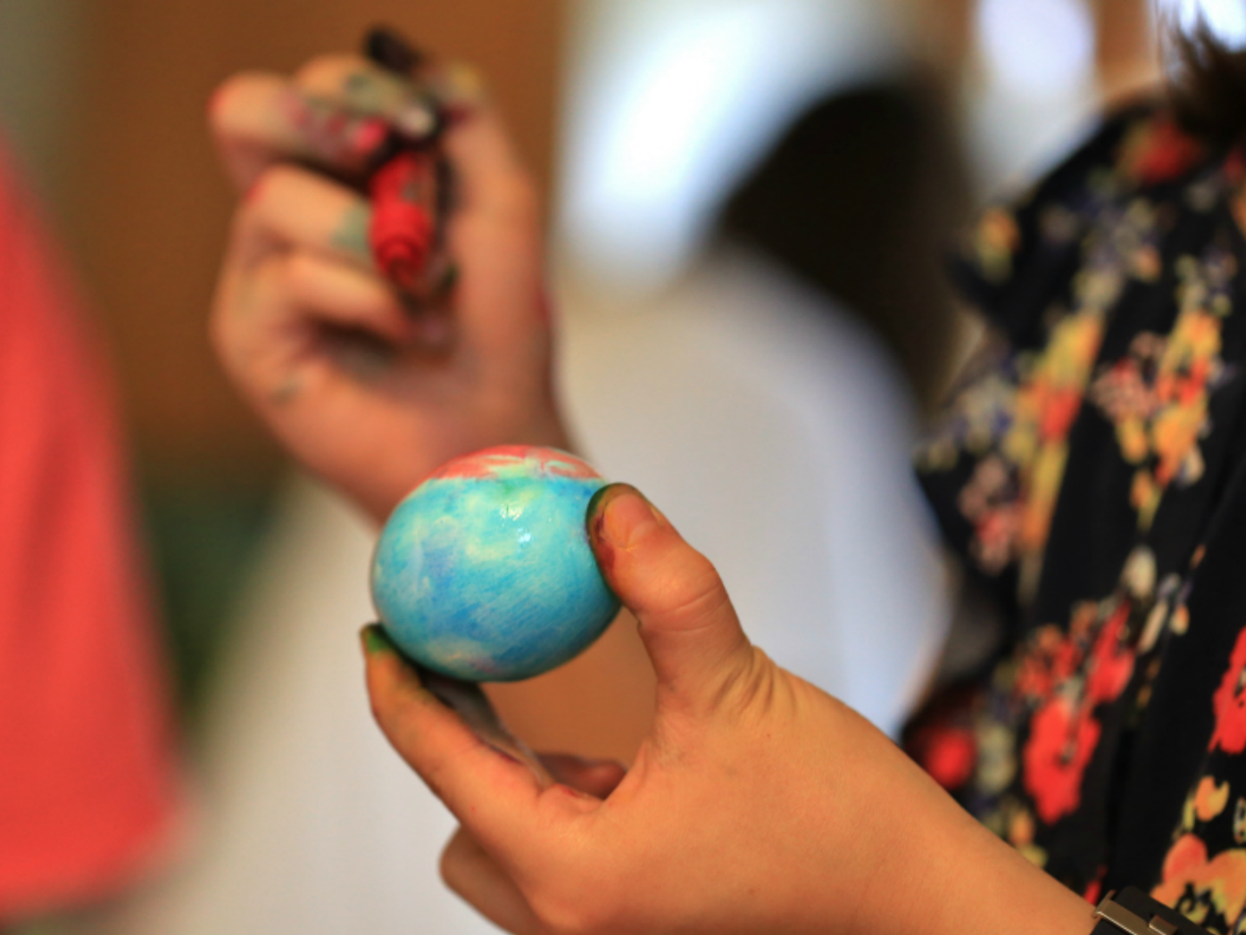 child coloring easter eggs with markers